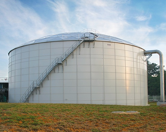 white bolted liquid storage tank with an aluminum dome cover