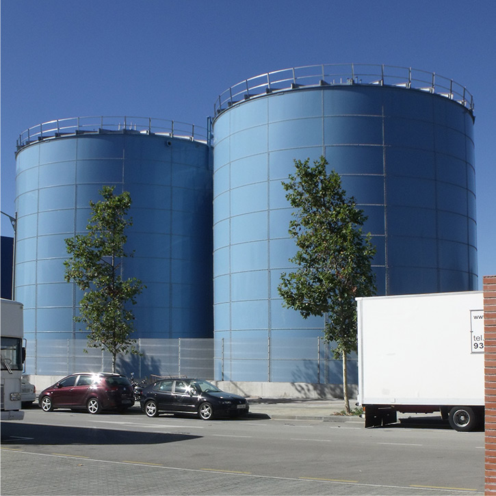 two blue anaerobic digester tanks