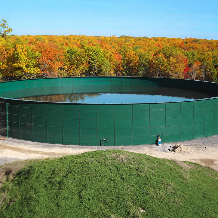 a green industrial liquid storage tank